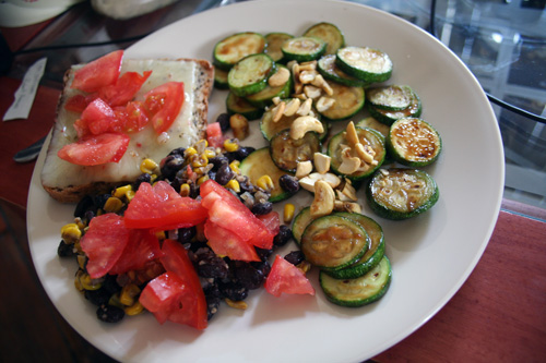 Topped with pepper jack - accompanied by zucchini with sweet-n-sour cashews, and black beans and corn with chunks of Hanover tomatoes.