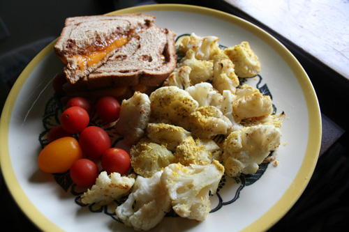 On Cinnamon-Raisin Swirl bread with a side of cherry tomatoes, cauliflower baked with s&p + nutritional yeast