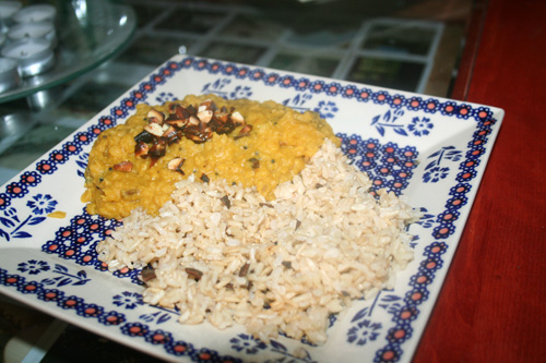 Pumpkin & lentil curry garnished with toasted almonds and served with cinnamon brown rice.