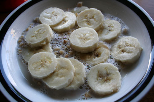 Warm soymilk with Nature's Path Hemp Plus granola and a sliced banana.